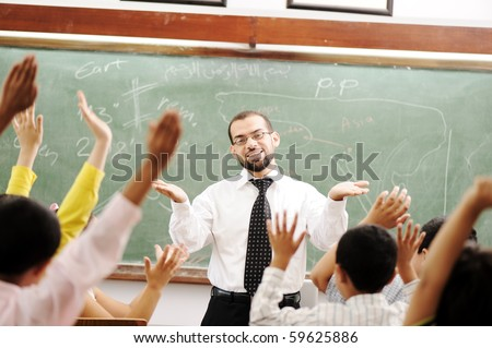 Interaction between teacher and children, funny class in school - stock photo
