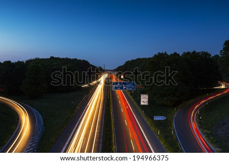 interchange aachen with light trails at the blue hour - stock photo