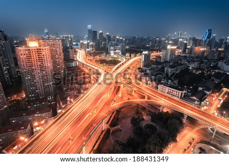 interchange overpass at night ,light trails on the city highway junction in shanghai  - stock photo