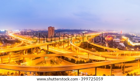 interchange overpass bridge panorama in nanjing at night - stock photo
