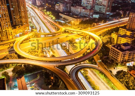 interchange road closeup ,urban traffic at night in guangzhou - stock photo