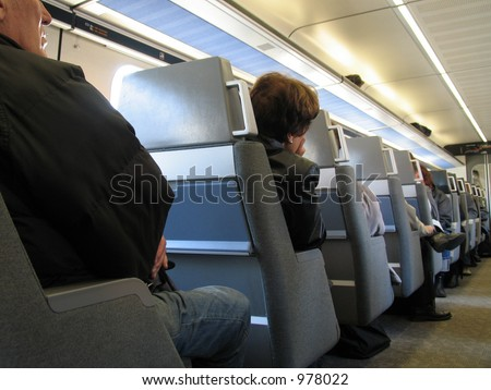 Intercity train Denmark.... people on their way to work...