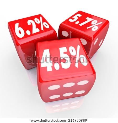 Interest rate numbers and percentages on three red dice to advertise special low rates on financing debt or credit cards - stock photo