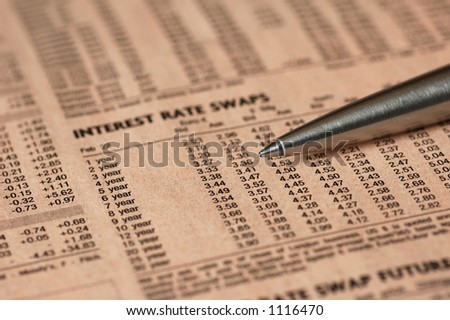 Interest rates over a financial newspaper - shallow dof