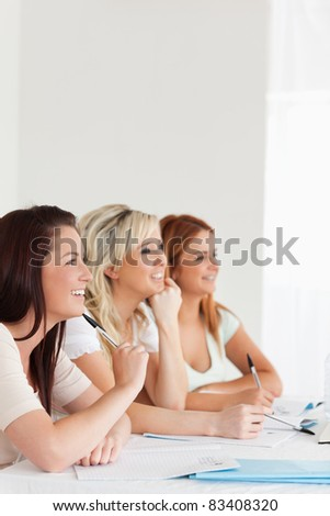Interested students sitting at a table in a university