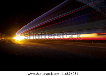 Interesting and abstract lights in orange, yellow and white that can be used as background or texture - stock photo