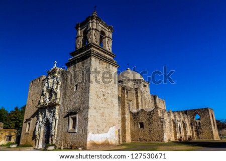Interesting Angle of the Bell Tower of the Historic Old West Spanish Mission San Jose, Founded in 1720, San Antonio, Texas.  Shot Taken December 2012. - stock photo