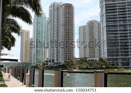 Interesting architecture of business buildings and ultra chic condominiums along the River Walk in Miami,Florida.   - stock photo