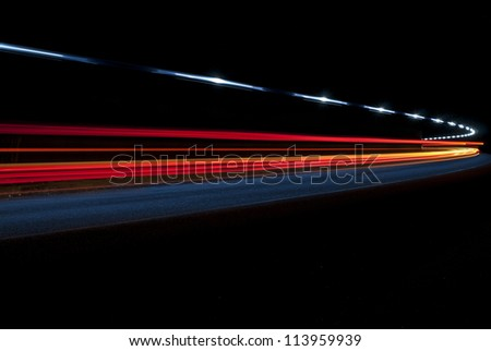 Interesting art lights from an ambulance in a road tunnel - stock photo