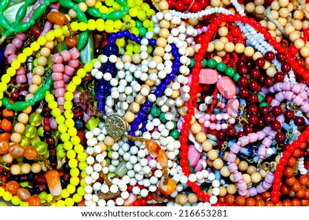 Interesting background with pile of retro jewelry - stock photo