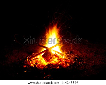 Interesting campfire with sparks - stock photo