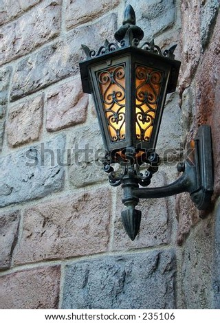 Interesting light fixture on brick wall - stock photo