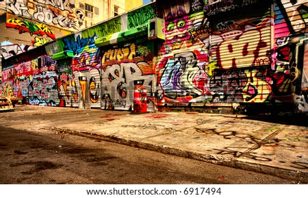 Interesting perspective graffiti on vandalised building - stock photo