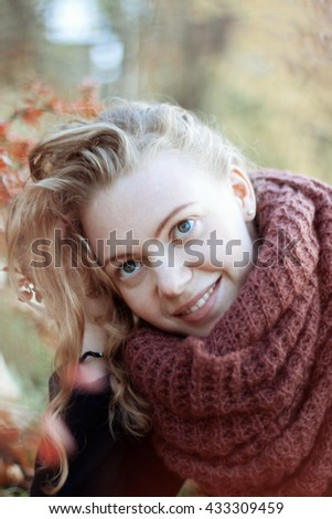interesting red-haired girl is doing a photo shoot in nature
