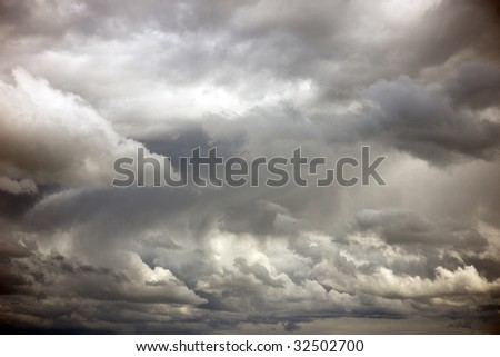 Interesting sky with grey clouds - stock photo