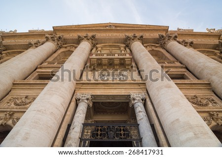 Interesting view from the bottom to top. Facade of the Saint Peter's Basilica (Basilica Papale di San Pietro in Vaticano) in Vatican City, Rome, Italy - stock photo