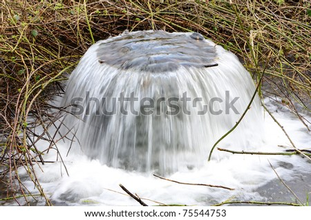 Interesting water outlet for a stream in the Columbia River Gorge - stock photo
