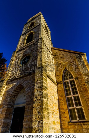 Interesting Wide Angle View of the Bell Tower of the Historic St. Mary's Catholic Church in Fredricksburg, TX., established 1846, current buildings 1863 and 1908. - stock photo