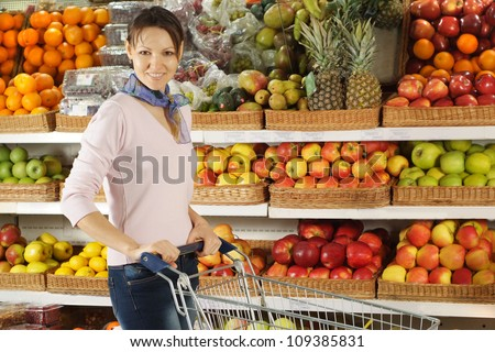 Interesting woman chooses products in the store