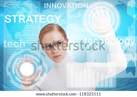 interface business office of the future, a woman in a blue modern background push on virtual buttons - stock photo