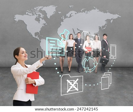 Interface business office of the future, a woman in office with map on background pushing on virtual buttons - stock photo