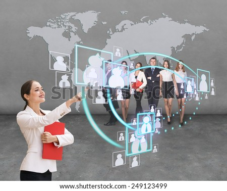 Interface business office of the future, a woman in office with map on background pushing on virtual buttons