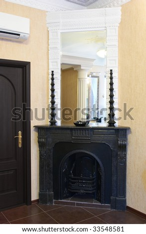 Interior about a fireplace - stock photo