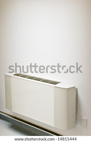 interior air-conditioner unit on white wall - stock photo