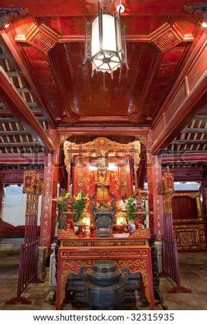 Interior altar of the Temple of Literature in Hanoi, Vietnam, featuring Chinese philosopher Confucius. - stock photo