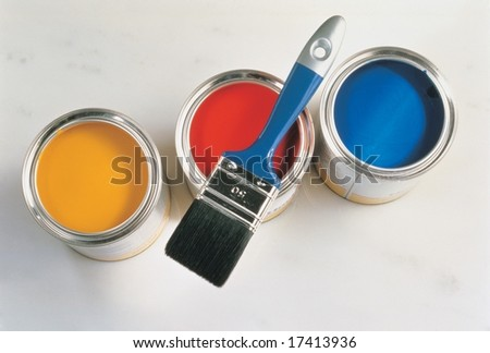 Interior and Decoration - a group of colorful paint cans with paintbrush isolated on silver background - stock photo