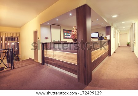 Interior and details of a small hotel reception.  - stock photo
