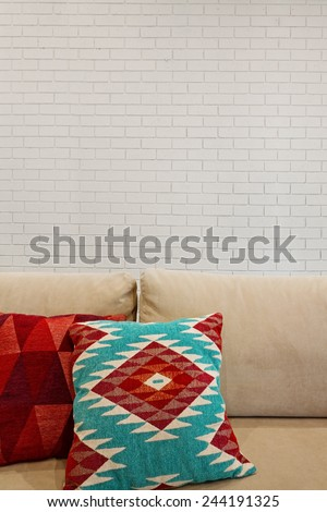 interior painted brick feature wall and sofa with space for text