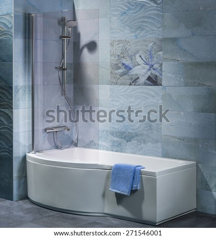interior bathroom with tub, shower and accessories - stock photo