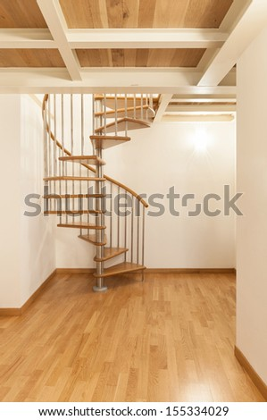 Interior, beautiful apartment, spiral staircases - stock photo