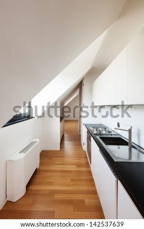 Interior, beautiful loft, hardwood floor, modern kitchen - stock photo