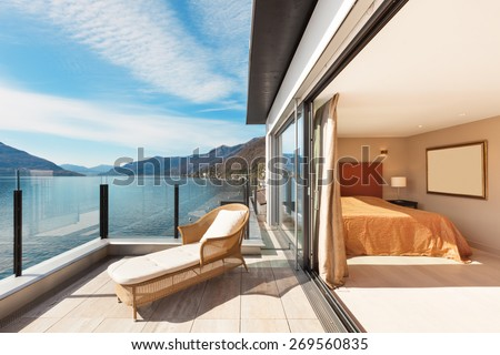 Interior, beautiful modern apartment, bedroom view from balcony - stock photo
