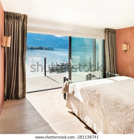 Interior, beautiful modern apartment, bedroom with window - stock photo