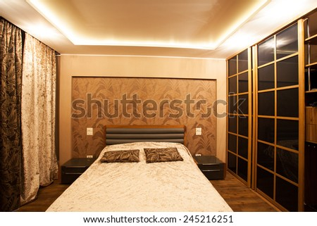 Interior bedroom. Bed in room at home. Hotel - stock photo