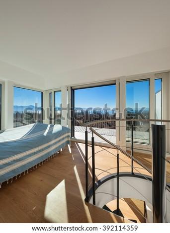 Interior, bright bedroom of a duplex, parquet floor - stock photo