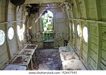 "Interior cabin view of crashed Russian Antonov An-2 Plane in the Peruvian Amazon. Nicknamed ""Annushka"" or ""Annie"". A single-engine biplane utility/agricultural aircraft designed in the USSR in 1946. - stock photo"