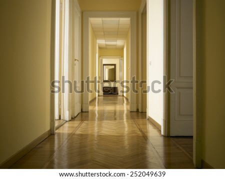 interior classic long corridor with parquet, nobody inside - stock photo