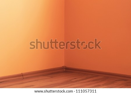 Interior corner of the room with wooden floor - stock photo