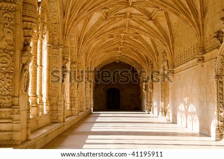 Interior corridor of the Mosteiro Dos Jeronimos, Lisbon, Portugal - stock photo