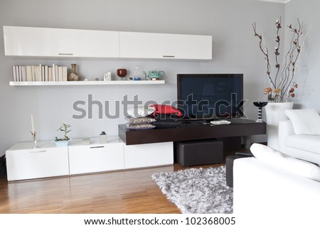Interior decoration of a apartment, flat tv white furniture - stock photo