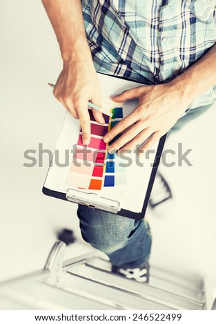 interior design and renovation concept - man with color samples for selection - stock photo