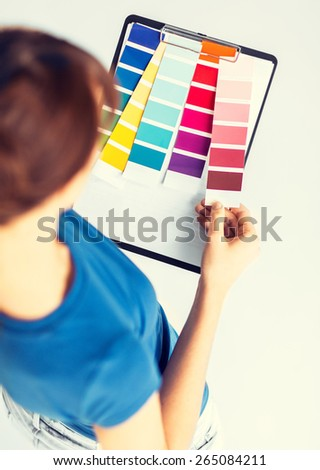 interior design and renovation concept - woman working with color samples for selection - stock photo