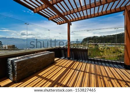 Interior design: Beautiful terrace lounge with pergola - stock photo