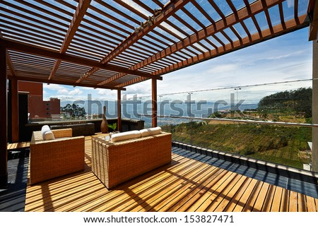 Interior design: Beautiful terrace lounge with pergola - stock photo