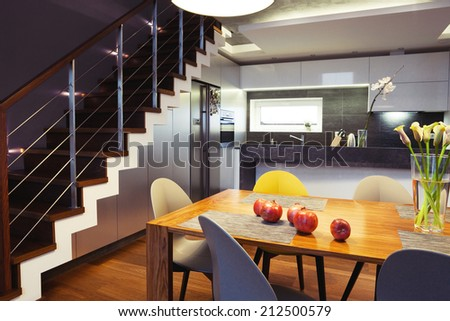 Interior design - dining table and chairs in a kitchen  - stock photo