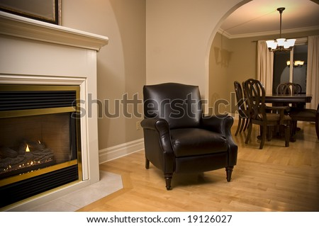 Interior design fireplace leather chair and dining room - stock photo